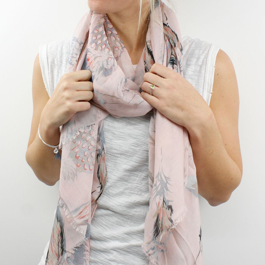 Blush pink scarf with frayed edges and pretty feather print in pastel blue, coral, grey and black.  Approx size 80cm x 180cm